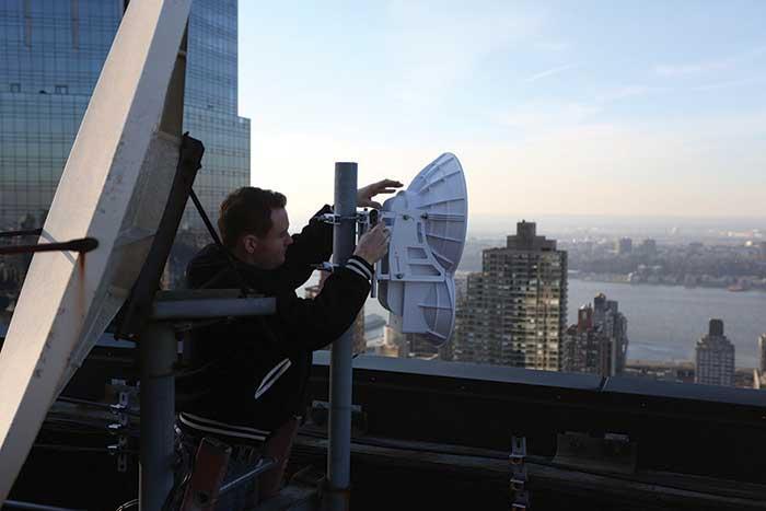 MST technician installs Ubiquiti airFiber radio